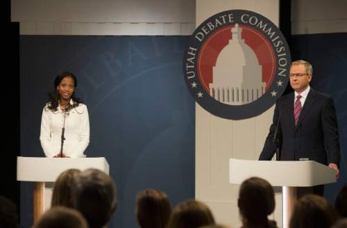Steve Griffin     Tribune file photo   Mia Love and Doug Owens debate at the Dolores Doré Eccles Broadcast Center on the University of Utah campus in Salt Lake City, Tuesday, October 14, 2014.  A Tribune/Hinckley poll shows that  Owens is ahead of  Love by six points. Political handicappers are calling 2016's race a tossup.
