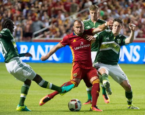 Rick Egan  |  The Salt Lake Tribune  Real Salt Lake forward Yura Movsisyan (14)  tries to get to the ball, as Portland Timbers midfielder Diego Chara (21) and Portland Timbers midfielder Ben Zemanski (14) defend, in MLS soccer action, Real Salt Lake vs. Portland Timbers, in Sandy, Friday, June 18, 2016.