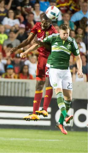 Rick Egan  |  The Salt Lake Tribune  Real Salt Lake defender Aaron Maund (21) goes for the ball along with Portland Timbers midfielder Diego Chara (21), in MLS soccer action, Real Salt Lake vs. Portland Timbers, in Sandy, Friday, June 18, 2016.