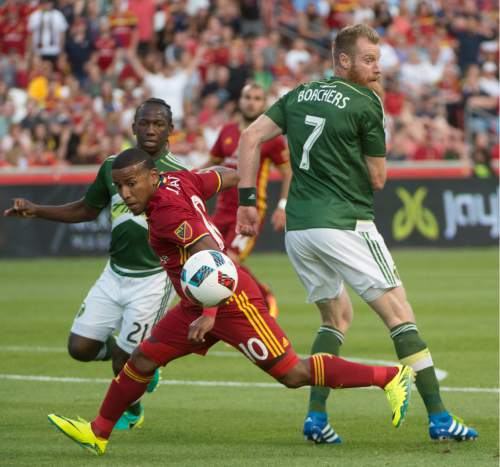 Rick Egan  |  The Salt Lake Tribune  Real Salt Lake forward Joao Plata (10) goes for the ball, as Portland Timbers midfielder Diego Chara (21) and Portland Timbers defender Nat Borchers (7) defend, in MLS soccer action, Real Salt Lake vs. Portland Timbers, in Sandy, Friday, June 18, 2016.