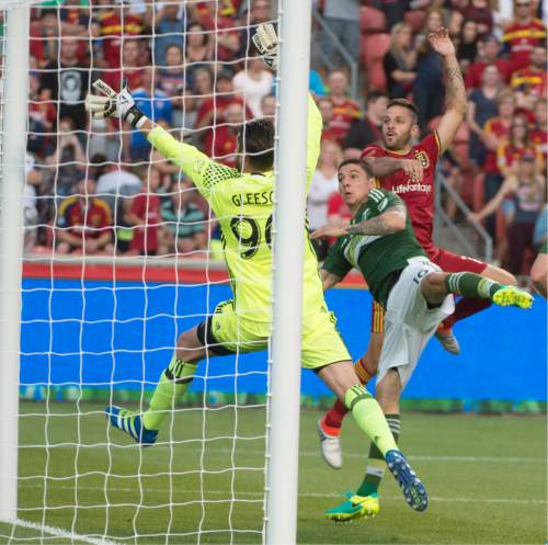 Rick Egan  |  The Salt Lake Tribune  Real Salt Lake forward Juan Martinez (7) heads the ball into the net for a goal, in MLS soccer action, Real Salt Lake vs. Portland Timbers, in Sandy, Friday, June 18, 2016.