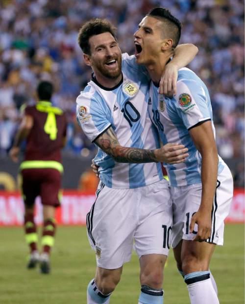 Argentina's Erik Lamela, right, celebrates his goal against Venezuela with Lionel Messi during the second half of a Copa America Centenario quarterfinal soccer match Saturday, June 18, 2016, in Foxborough, Mass. (AP Photo/Elise Amendola)