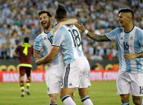 Argentina's Erik Lamela (18) celebrates his goal against Venezuela with Lionel Messi, left, and Marcos Rojo during the second half of a Copa America Centenario quarterfinal soccer match on Saturday, June 18, 2016, in Foxborough, Mass. (AP Photo/Elise Amendola)