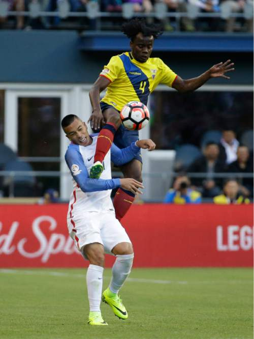 Ecuador's Juan Carlos Paredes ,top, jumps over United States' Bobby Wood during a Copa America Centenario quarterfinal soccer match, Thursday, June 16, 2016 at CenturyLink Field in Seattle. United States won 2-1. (AP Photo/Elaine Thompson)
