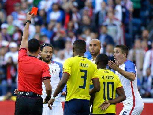 Referee Wilmar Roldan, left, shows a red card to United States midfielder Jermaine Jones second from left, in the second half of a Copa America Centenario soccer match against Ecuador, Thursday, June 16, 2016 at CenturyLink Field in Seattle. The United States beat Ecuador 2-1. (AP Photo/Ted S. Warren)