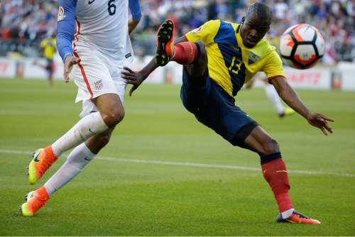 Ecuador's Enner Valencia, right,  and United States' John Brooks vie for the ball during a Copa America Centenario quarterfinal soccer match, Thursday, June 16, 2016 at CenturyLink Field in Seattle. United States won 2-1. (AP Photo/Elaine Thompson)