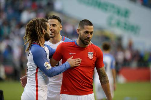 United States' Clint Dempsey , right,  is congratulated by Kyle Beckerman at the end of a Copa America Centenario quarterfinal soccer match against Ecuador, Thursday, June 16, 2016 at CenturyLink Field in Seattle. United States won 2-1. (AP Photo/Elaine Thompson)