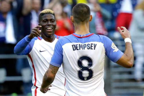 United States' Gyasi Zardes, left, is greeted by Clint Dempsey, 8, after Zardes scored a goal against Ecuador in the second half of a Copa America Centenario quarterfinal soccer match, Thursday, June 16, 2016 at CenturyLink Field in Seattle. The United States beat Ecuador 2-1. (AP Photo/Ted S. Warren)