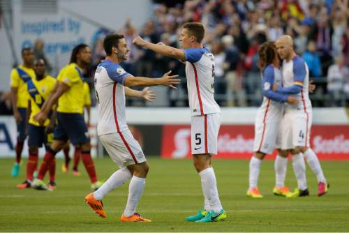 United States players celebrate at the end a Copa America Centenario quarterfinal soccer match against Ecuador, Thursday, June 16, 2016 at CenturyLink Field in Seattle. United States won 2-1. (AP Photo/Elaine Thompson)