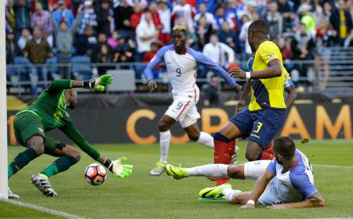United States forward Clint Dempsey, lower right, gets an assist past Ecuador goalkeeper Alexander Dominguez, left, so that United States forward Gyasi Zerdes, second from left, could tap the ball in for a goal in the second half of a Copa America Centenario soccer match, Thursday, June 16, 2016 at CenturyLink Field in Seattle. The United States beat Ecuador 2-1. (AP Photo/Ted S. Warren)