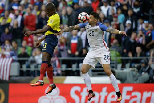Ecuador's Enner Valencia, left,  and United States' Geoff Cameron jump for the ball during a Copa America Centenario quarterfinal soccer match, Thursday, June 16, 2016 at CenturyLink Field in Seattle. United States won 2-1. (AP Photo/Elaine Thompson)