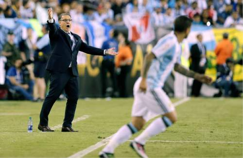 Argentina coach Gerardo Martino, left, gestures during the second half of the team's Copa America Centenario quarterfinal soccer match against Venezuela on Saturday, June 18, 2016, in Foxborough, Mass. (AP Photo/Charles Krupa)