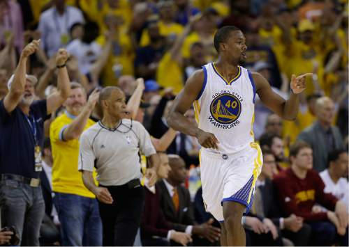Golden State Warriors forward Harrison Barnes (40) gestures after scoring against the Cleveland Cavaliers during the second half of Game 7 of basketball's NBA Finals in Oakland, Calif., Sunday, June 19, 2016. (AP Photo/Marcio Jose Sanchez)
