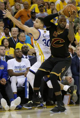 Cleveland Cavaliers forward LeBron James (23) is defended by Golden State Warriors guard Stephen Curry (30) during the second half of Game 7 of basketball's NBA Finals in Oakland, Calif., Sunday, June 19, 2016. (AP Photo/Marcio Jose Sanchez)