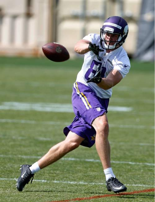 FILE - In this May 6, 2016, file photo, Minnesota Vikings wide receiver Moritz Boehringer, of Germany, pulls in a pass during the NFL football team's rookie minicamp in Eden Prairie, Minn. Boehringer's size and speed captured the attention of the Vikings, who took a chance on a raw wide receiver in the sixth round of the draft. (AP Photo/Jim Mone, File)