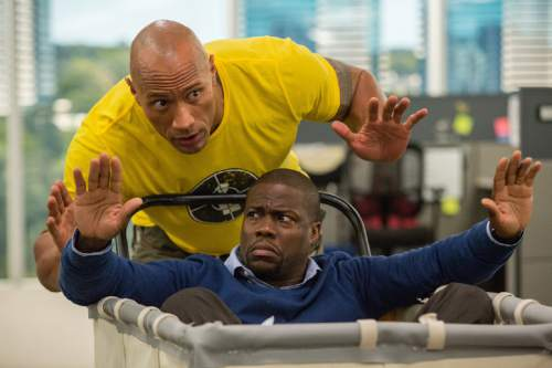 """This image released by Warner Bros. Entertainment shows Kevin Hart, bottom, and Dwayne Johnson in a scene from, """"Central Intelligence."""" (Claire Folger/Warner Bros. Entertainment Inc. via AP)"""