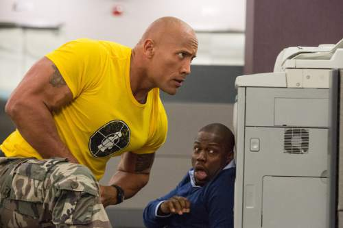 """This image released by Warner Bros. Entertainment shows Dwayne Johnson, left, and Kevin Hart in a scene from, """"Central Intelligence."""" (Claire Folger/Warner Bros. Entertainment Inc. via AP)"""