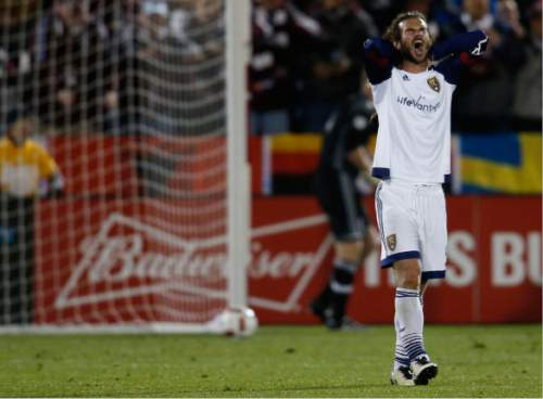 Real Salt Lake midfielder Kyle Beckerman reacts after a shot was stopped by Colorado Rapids goalkeeper Zac MacMath in the second half of an MLS soccer game in Commerce City, Colo., late Saturday, May 7, 2016. The Rapids won 1-0. (AP Photo/David Zalubowski)