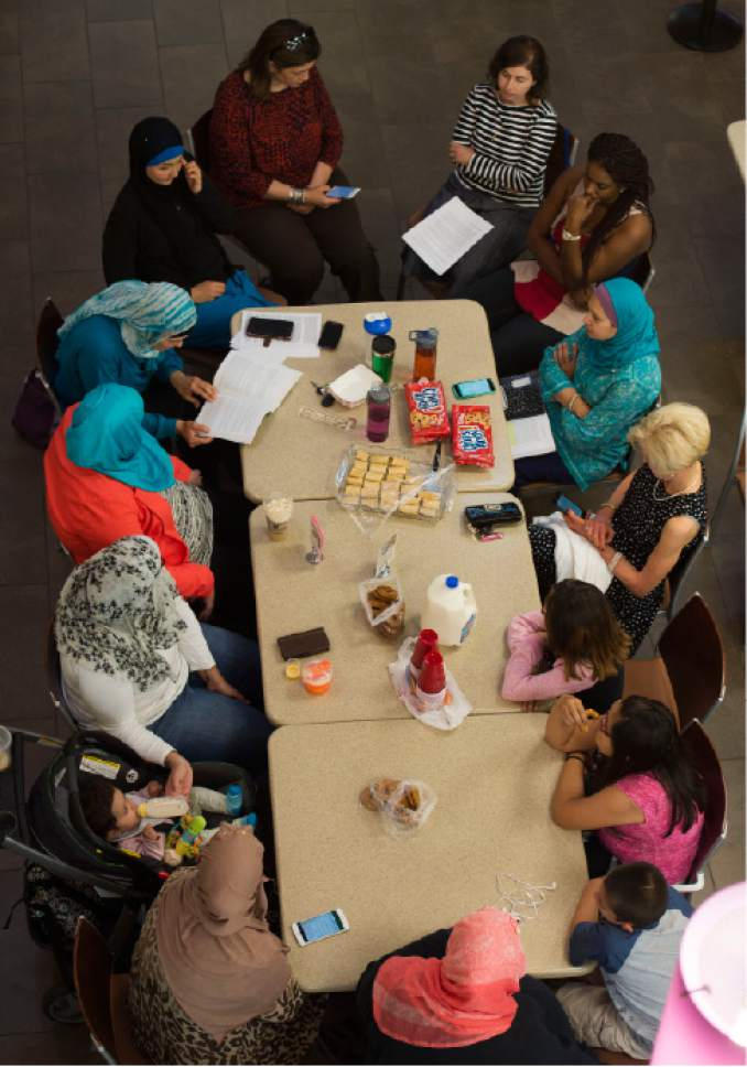 Steve Griffin / The Salt Lake Tribune  Maysa Kergaye reads from the Quran as she leads a discussion at the Millcreek Library on Thursday June 2, 2016.