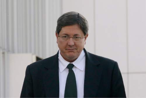 FILE - In this Jan. 21, 2015, file photo, high-ranking polygamous leader Lyle Jeffs leaves the federal courthouse, in Salt Lake City. Polygamous sect leader Jeffs is being let out of jail pending trial on accusations he helped orchestrate a multimillion-dollar food stamp fraud scheme. U.S. District Judge Ted Stewart in Salt Lake City on Thursday, June 9, 2016 granted Jeffs' latest request to be released, citing the fact that the other 10 defendants already out have complied with conditions set by the court. (AP Photo/Rick Bowmer, File)