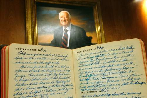 Scott Sommerdorf  l  The Salt Lake Tribune A portrait of Leonard J. Arrington hangs in USU's Merrill-Cazier Library where the writings of the former LDS Church historian are kept. An early 1935 Arrington diary  is in the foreground.