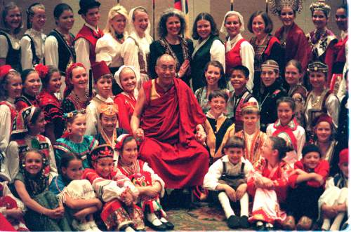 The Dalai Lama visits with the International Children's Choir at the Marrioltt Hotel during his visit to Utah in 2001. Photo by Rick Egan