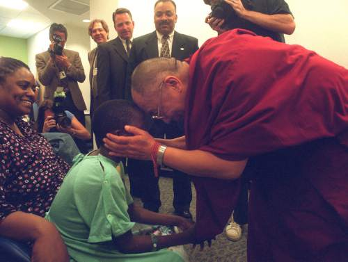 The Dalai Lama talks to Brandon Murphy at Primary Children's Hospital during his 2001 visit.  Photo by Rick Egan