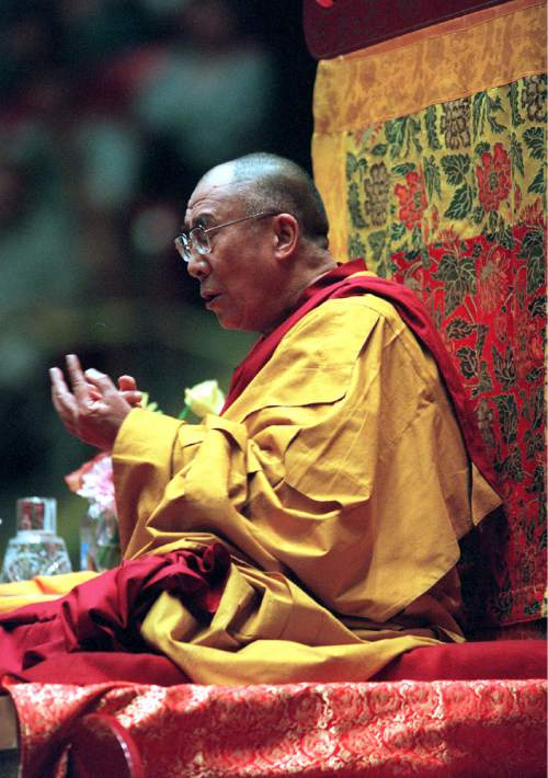 The Dalai Lama talks about the Six Perfections of Buddhism at the Huntsman Center during his 2001 visit. Photo by RIck Egan
