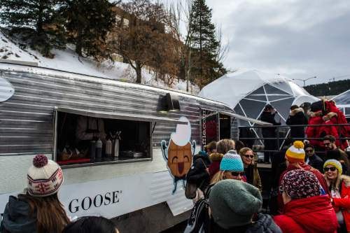 Chris Detrick  |  The Salt Lake Tribune Festivalgoers wait to get their Canadian waffles at Festival Base Camp during the Sundance Film Festival in Park City Saturday January 23, 2016.