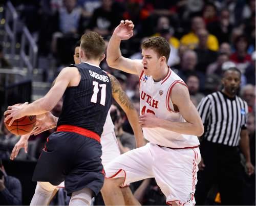 Scott Sommerdorf   |  The Salt Lake Tribune   Utah F Jakob Poeltl (42) tries to defend against Gonzaga F Domantas Sabonis (11) during second half play. Gonzaga beat Utah 82-59 in Denver, Saturday, March 19, 2016.