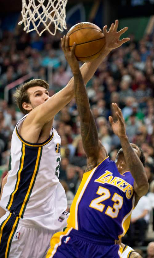 Lennie Mahler  |  The Salt Lake Tribune  Jazz center Jeff Withey fouls Lou Williams during a game between the Utah Jazz and the Los Angeles Lakers at Vivint Smart Home Arena in Salt Lake City, Saturday, Jan. 16, 2016.