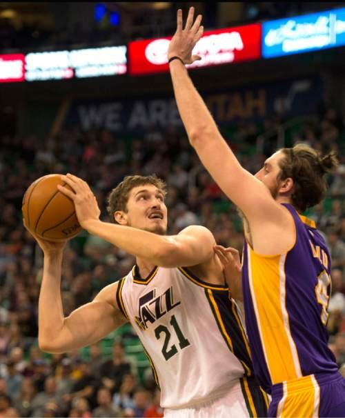 Rick Egan  |  The Salt Lake Tribune  Utah Jazz center Tibor Pleiss (21) looks for a shot, as Los Angeles Lakers forward Ryan Kelly (4) defends, in NBA action, The Utah Jazz vs. The Los Angeles Lakers, in Salt Lake City, Saturday, January 16, 2016.