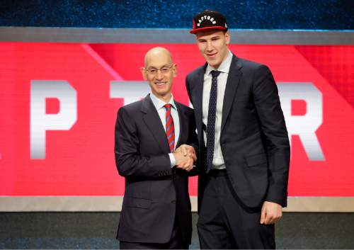 Jakob Poeltl, right, poses for a photo with NBA Commissioner Adam Silver after being selected ninth overall by the Toronto Raptors during the NBA basketball draft, Thursday, June 23, 2016, in New York. (AP Photo/Frank Franklin II)