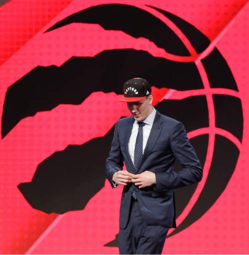 Jakob Poeltl walks off stage after being selected ninth overall by the Toronto Raptors during the NBA basketball draft, Thursday, June 23, 2016, in New York. (AP Photo/Frank Franklin II)