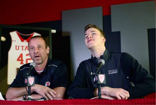 Scott Sommerdorf   |  The Salt Lake Tribune   Jakob Poeltl cranes his neck as he acknowledges team mates entering to watch the press conference as he announced that he's decided to enter the NBA Draft. Utah head coach Larry Krystkowiak joined him in the press conference at the Utah practice facility, Wednesday, April 13, 2016.