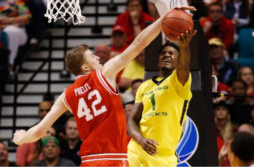 Utah forward Jakob Poeltl (42) blocks a shot by Oregon forward Jordan Bell during the first half of an NCAA college basketball game in the championship of the Pac-12 men's tournament Saturday, March 12, 2016, in Las Vegas. (AP Photo/John Locher)