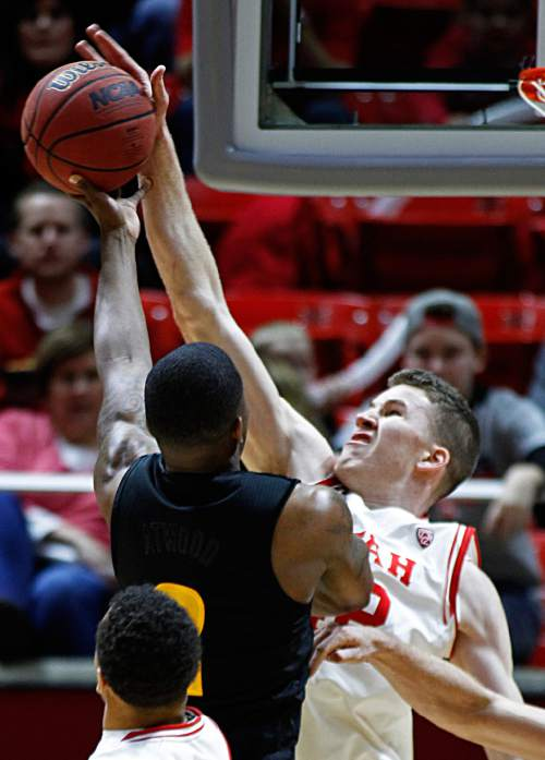 Utah forward Jakob Poeltl (42) blocks the shot of Arizona State forward Willie Atwood (2) during the first half of an NCAA college basketball game in Salt Lake City, Thursday, Feb. 25, 2016. (AP Photo/George Frey)