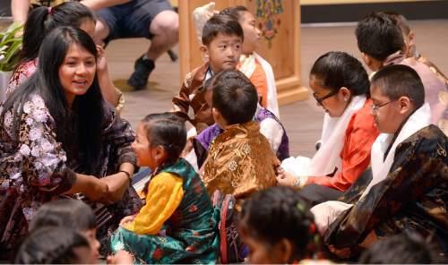 Al Hartmann     The Salt Lake Tribune  Members and friends gather at the Tibetan Utah Community Center in Salt Lake City Wednesday June 22 where the Dalai Lama will be speaking.