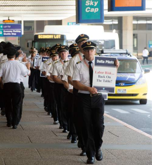 Steve Griffin  |  The Salt Lake Tribune About 100 Delta Airlines pilots participate in a national picket to protest salaries at the Salt Lake City International Airport on Friday.