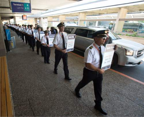 Steve Griffin / The Salt Lake Tribune  About 100 Delta Airlines pilots participate in a national picket to protest salaries at the Salt Lake City International Airport, Friday June 24, 2016.