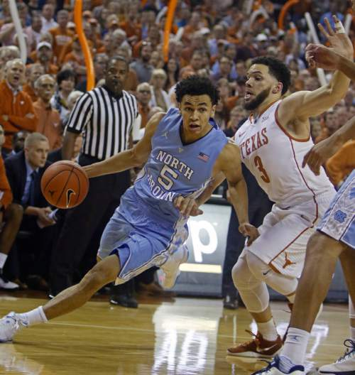North Carolina guard Marcus Paige (5) drives the ball against Texas guard Javan Felix (3) during the first half of an NCAA college basketball game, Saturday, Dec. 12, 2015, in Austin, Texas. (AP Photo/Michael Thomas)