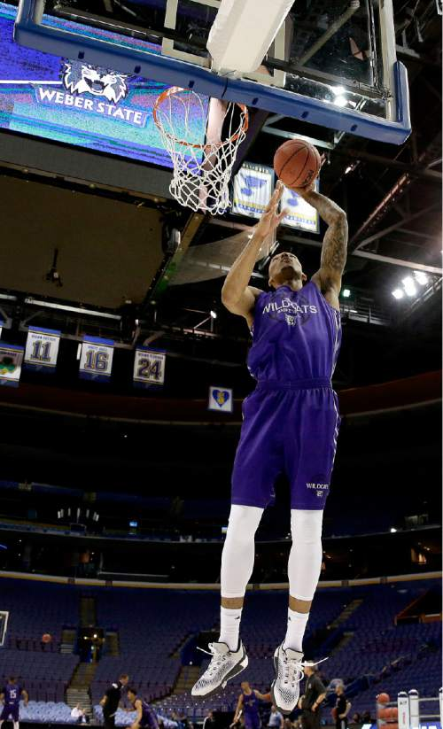 Weber State's Joel Bolomboy shoots during practice ahead of a first-round men's college basketball game in the NCAA tournament, Thursday, March 17, 2016, in St. Louis. Weber State plays Xavier on Friday. (AP Photo/Charlie Riedel)