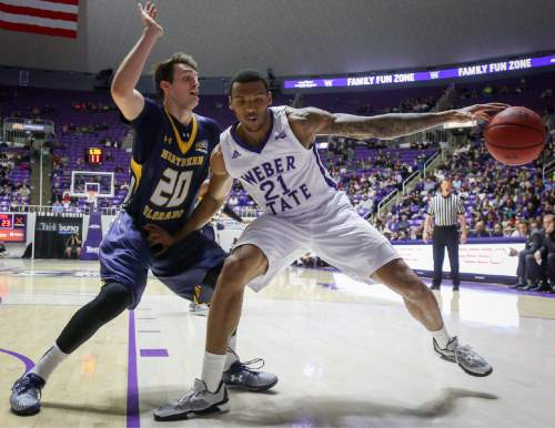 Weber State's Joel Bolomboy tries to get around Northern Colorado's Tanner Morgan during an NCAA college basketball game Saturday, Jan. 9, 2016, in Ogden, Utah. Weber State defeated Northern Colorado 85-68. (Benjamin Zack/Standard-Examiner via AP)