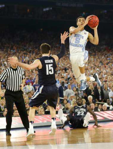 North Carolina guard Marcus Paige (5) shoots over Villanova guard Ryan Arcidiacono (15) during the second half of the NCAA Final Four tournament college basketball championship game Monday, April 4, 2016, in Houston. (AP Photo/David J. Phillip)