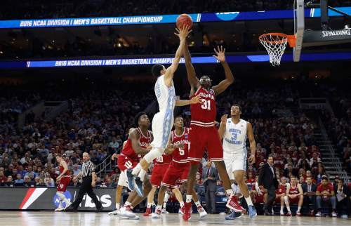 North Carolina's Marcus Paige, left, releases a shot against Indiana's Thomas Bryant during the first half of an NCAA college basketball game in the regional semifinals of the men's NCAA Tournament, Friday, March 25, 2016, in Philadelphia. (AP Photo/Matt Rourke)