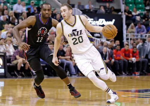 Utah Jazz forward Gordon Hayward (20) drives around Los Angeles Clippers forward Luc Richard Mbah a Moute (12) during the first quarter of an NBA basketball game Friday, April 8, 2016, in Salt Lake City. (AP Photo/Rick Bowmer)