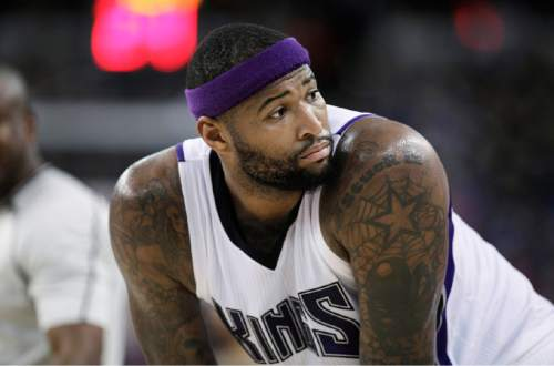 Sacramento Kings center DeMarcus Cousins pauses before shooting free throws during the second half of the team's NBA basketball game against the Indiana Pacers in Sacramento, Calif., on Saturday, Jan. 23, 2016. The Kings won 108-97. (AP Photo/Steve Yeater)