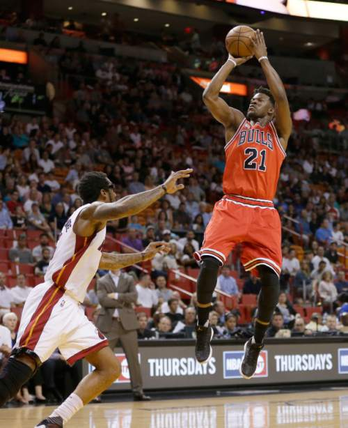 Chicago Bulls guard Jimmy Butler (21) shoots against Miami Heat forward Amar'e Stoudemire (5) in the first half of an NBA basketball game, Thursday, April 7, 2016, in Miami. (AP Photo/Alan Diaz)