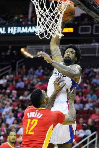 Los Angeles Clippers' DeAndre Jordan, right, shoots over Houston Rockets' Dwight Howard (12) in the first half of an NBA basketball game Wednesday, March 16, 2016, in Houston. (AP Photo/Pat Sullivan)