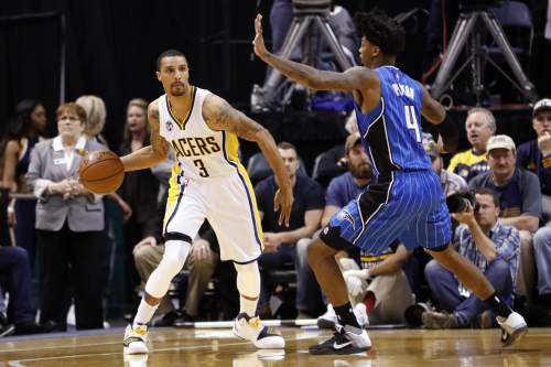 Indiana Pacers guard George Hill (3) looks to pass around Orlando Magic guard Elfrid Payton (4) during the first half of an NBA basketball game in Indianapolis, Thursday, March 31, 2016. (AP Photo/AJ Mast)